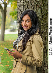 woman listening to music on mobile phone - a young woman...