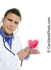 Doctor test a red heart health, young man isolated on white