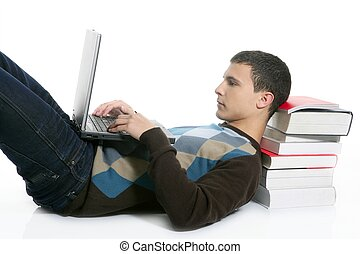 Student boy lying on floor, books and computer - Student boy...