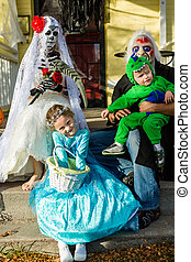 Halloween night - Trick or treating in costumes on Halloween...