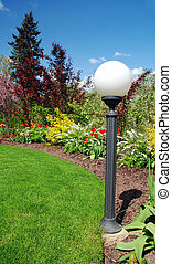 Garden and lamp - Beautiful spring garden with lamp and blue...