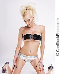 beautyfull sexy blonde glamour model wearing silver pants