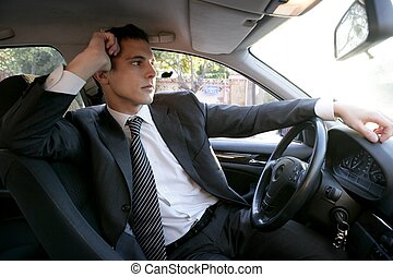 Young suit businessman inside his car