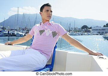 Young handsome man relaxed on a boat