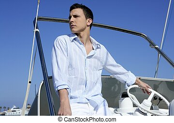 Handsome young man on boat, summer vacation - Handsome young...