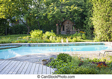 Garden and swimming pool in backyard - Backyard with garden,...