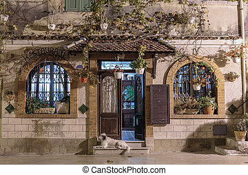 Entrance to the restaurant of the old village house at...