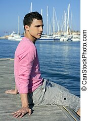 Handsome young man on summer in harbor