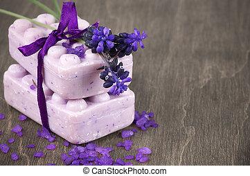 Lavender soap and bath salt on wooden background