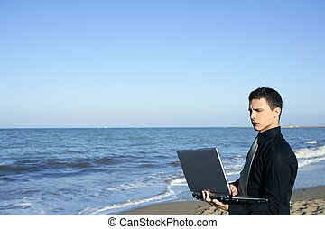 Handsome young businessman computer beach - Handsome young...