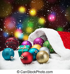 Christmas balls and gifts on the background of falling snow