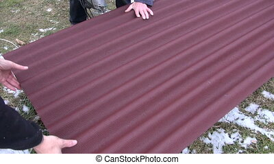 cut with saw roof sheet - worker cut with electric saw roof...