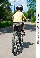 Kid riding bicycle