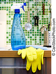 Kitchen cleaning - Blue cleaning spray bottle on kitchen...