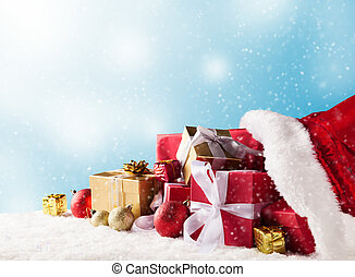 Christmas bag with gifts - Santa Claus bag full of gifts on...
