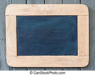Black board - Blackboard hanging on wooden wall as a...