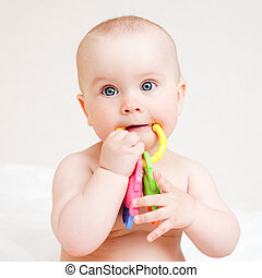 Infant with teething toy - Little baby girl with teething...