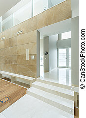 White and beige spacious interior - Vertical view of white...
