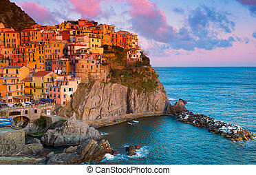 Picturesque view of Manarola, Laguria, Italy on a sunset