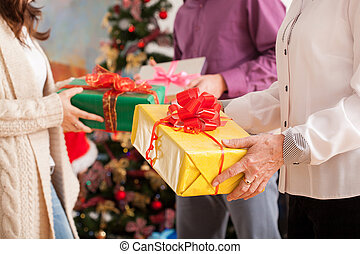 Christmas gifts - Happy family exchanging theirs Christmas...