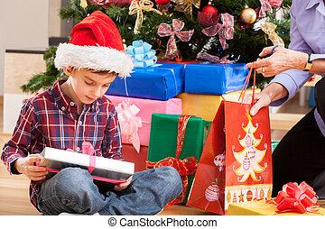 Boy and his present - Little boy opening his present