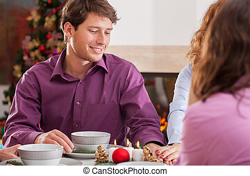 Christmas supper - Young couple and romantic Chritmas supper