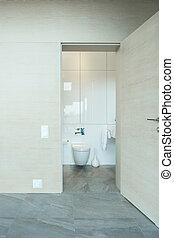 Toilet door open - Vertical view of white toilet door open