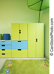 Modern room for child with green furniture and carpet
