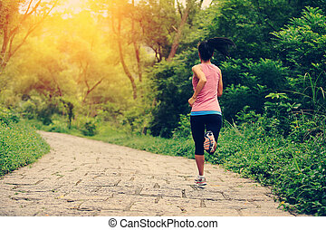 fitness woman runner running on stone trail