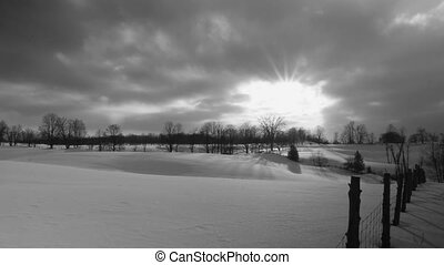 Snowy fields. Timelapse. - Timelapse of sun going down over...