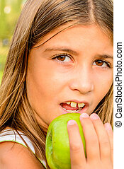Beautiful nine year old girl eating apple - Beautiful nine...