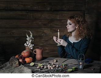 Witch preparing potion - The red-haired witch preparing a...