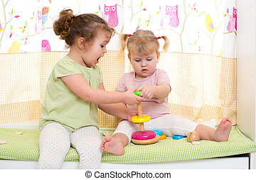 two children sisters play together