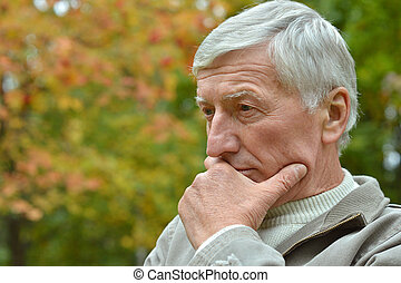Senior man thinking - Portrait of senior man thinking about...