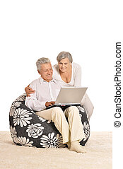 couple relaxing at home - Mature couple relaxing at home...