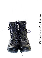 Old and dusty combat boots isolated on white.