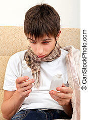 Sick Teenager looking on Drug Bottles - Sick Teenager choice...