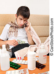Sick Teenager home - Sick Teenager with Cellphone checking...