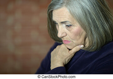 thinking elderly woman - Portrait of thinking elderly woman...