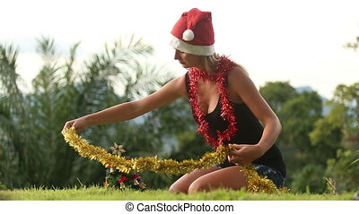 young girl in christmas hat dress gold rain on her neck -...