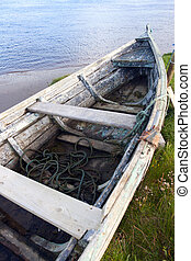 old row boat on the river bank - old row boat on the bank of...