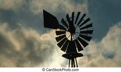 Winter windmill. Closeup. - Winter windmill used as a water...