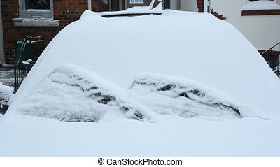 Winter wipers clearing snow. - Starting a snow covered car....