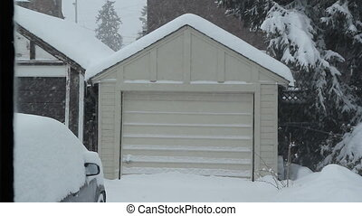 Winter garage. - Small one car garage during a snowstorm....