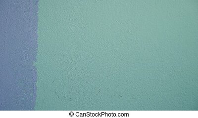 Painting walls with a roller - Repainted green with purple...