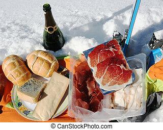 pic nic on the snow with tipical mountain food sa