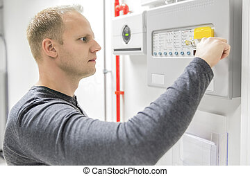 Technician test fire panel in data center - IT engineer or...