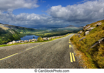 Mountain Road - Mountain road with hills in background in...