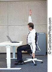 exercises in office business man taking short break for...