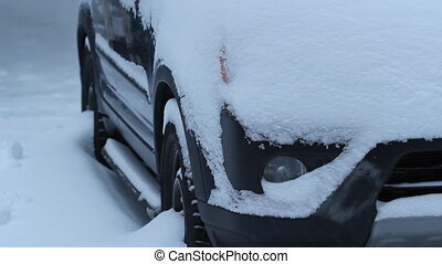 Winter headlight - Snow covered SUV with engine running...